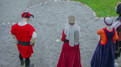 Princesses watch knights go out of the castle Stock Footage