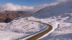 Crown Range road New Zealand, Aerial pan up, winter Stock Footage
