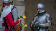 Princess is giving yellow roses to the knights Stock Footage