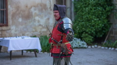 A knight is lifting his sword up - stock footage