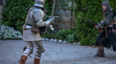 Two knights start fencing with swords Stock Footage
