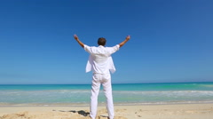 Young man on beach hold hands arms up Vacation concept of freedom travel - stock footage