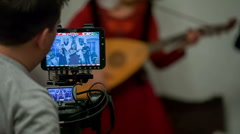 Playing a tambura Stock Footage