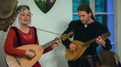 Two members of a royal family are playing tambura and singing Stock Footage