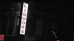 Establishing shot of a Liquor store exterior at night. Stock Footage