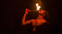 Fire-eater during his performance Stock Footage