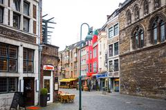 Aachen, Germany - April 13 : Tourists on foot Street in Aachen, Germany. Aach - stock photo