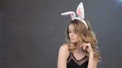 Girl shows surprise with bunny ears on her head - stock footage