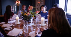 4K Happy diverse group chatting at large table in elegant restaurant Stock Footage