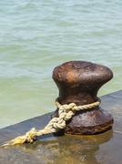 Iron rusty mooring bollard Stock Photos