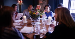 4K Happy friends of mixed ages chatting as they look at menus in restaurant Stock Footage