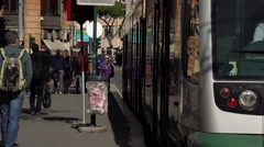 Commuter: travelers in the city go up on a tramway Stock Footage