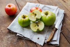 Healthy snack background - red and green apples on rustic wooden background. Stock Photos