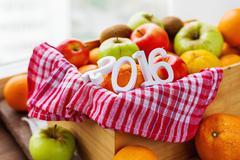 Box full of fresh fruits. Fruit harvest of 2016 year - apples, oranges, lemon - stock photo