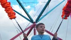 Kid jumping. Happy childhood summer plesure Stock Footage