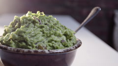 A panning shot of a bowl of fresh guacamole Stock Footage