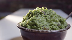 Fresh homemade Guacamole and tortilla chips - closeup shot - stock footage