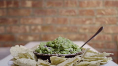 panning shot Fresh homemade Guacamole and tortilla chips. - stock footage