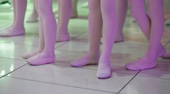 feet of young girls and boys dancing slippers - stock footage