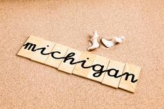 Words on sand Michigan - stock photo