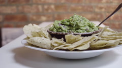 Fresh homemade Guacamole and tortilla chips. Stock Footage