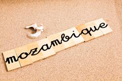 Words on sand Mozambique - stock photo