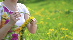 Girl weaves a wreath Stock Footage