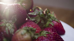 freshly picked strawberries ready to eat - stock footage