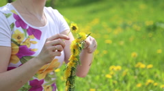 Mother and daughter weave a wreath - stock footage