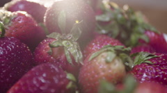 Freshly picked strawberries on a rotating display Stock Footage