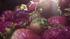 Farm  fresh strawberries ready to eat on the breakfast table in the morning sun - stock footage