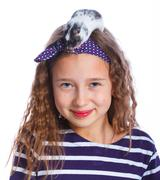 Cute girl holding a hamster - stock photo
