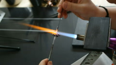 Lampworking - making a glass bead in flame Stock Footage