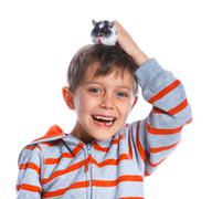 Cute boy with hamster - stock photo