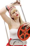 Sexy pin-up with a film reel, on white Stock Photos