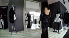 Hispanic female try dress on in fashion designer and tailor studio, looking a Stock Footage