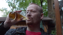 Man Drinking Beer at an Outdoor Cafe - stock footage