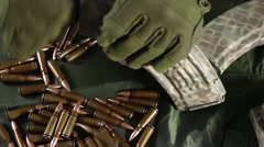 Prepare weapons for battle. Equipment bullets. Close-up Stock Footage