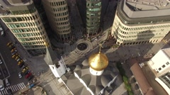 And steel office buildings. Orthodox church dome. People walk at the street. Aer Stock Footage