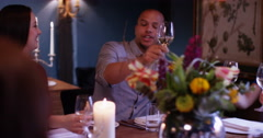 4K Happy adult family group raise their wine glasses for a toast in restaurant Stock Footage