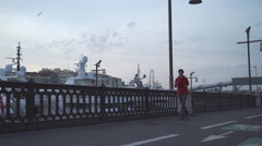 Young woman running in harbor in the morning Stock Footage
