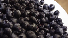 Closeup shot of fresh blueberries at brunch. Stock Footage