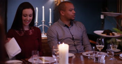 4K Waitress brings happy young couple's dishes to the table in elegant restauran Stock Footage