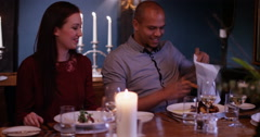 4K Couple in elegant restaurant take pleasure in the presentation of their meals Stock Footage