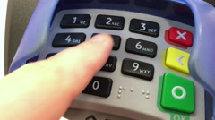 Person entering pin number at debit card pay terminal 4k Stock Footage