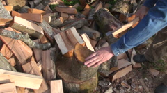Farmer chopping wood outdoors Stock Footage