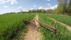 Old rusty horse draw plow in field by forest, time lapse 4K Stock Footage