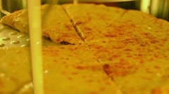 Close up view of rotating Pizza in fast food store Stock Footage