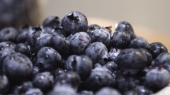 Closeup shot of fresh blueberries in a brown bowl at brunch Stock Footage