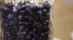 Freshly picked, farm fresh blueberries in mason jar. - stock footage